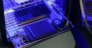 UVC Light sterilizing wallet, phone and car keys