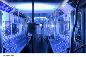 Germicidal UVC light sanitizing the inside of a subway car